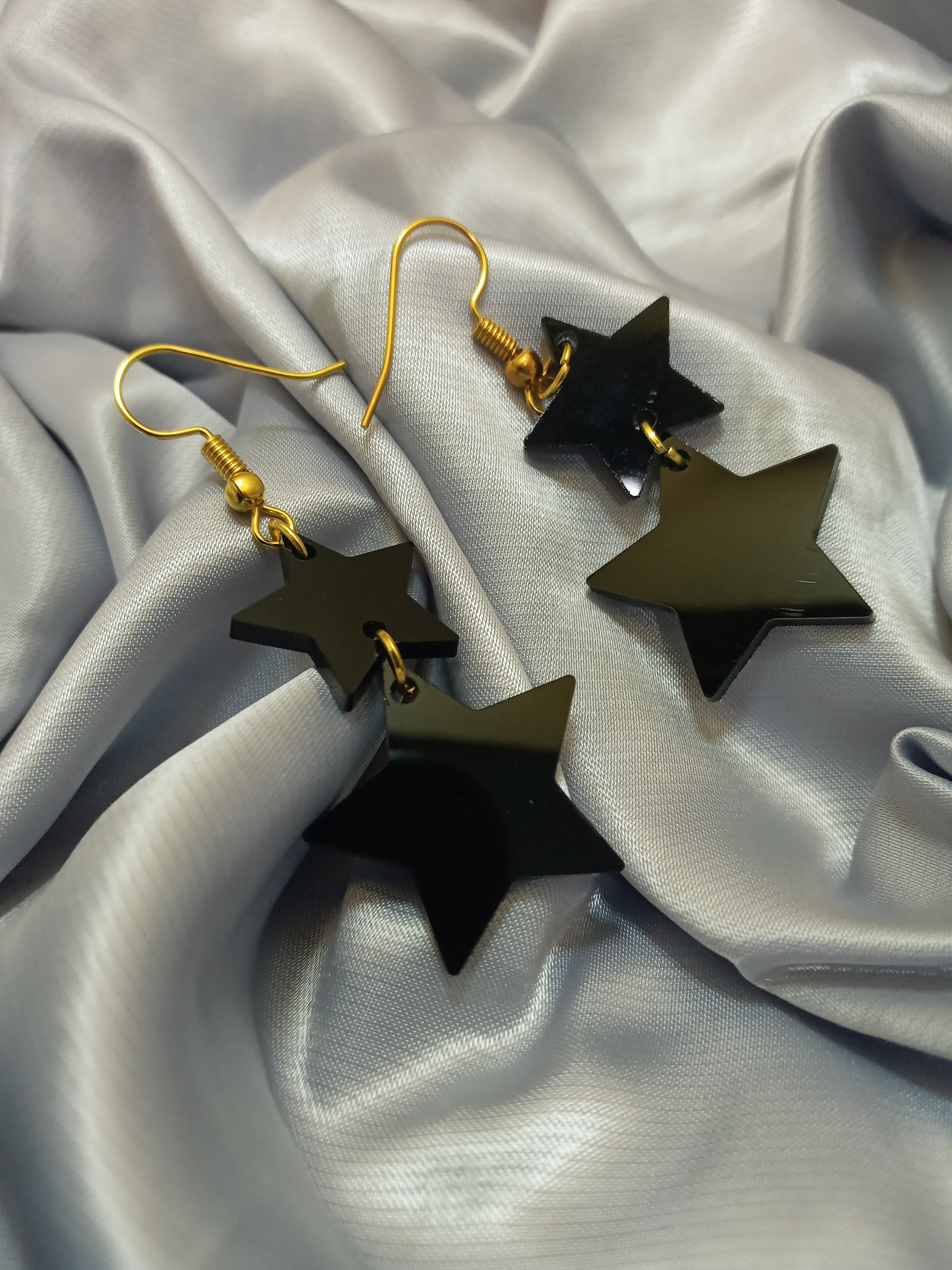 products  Two star earrings